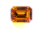 0.69 carat Emerald cut Fancy Orange Cognac diamond